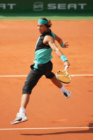 rafael-nadal-hitting-one-handed-backhand.jpg