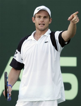 Andy Roddick from U.S., reacts, during a match with Russia's Nikolay Davydenko during the first day of Capitala World Tennis Championship in Abu Dhabi, United Arab Emirates, Thursday, Jan. 1, 2009.