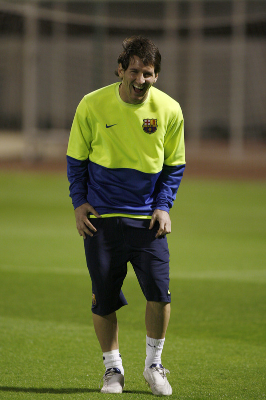 lionel messi 2009. Lionel Messi laughs as he