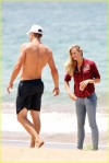 Brooklyn Decker wanders down to the beach in Hawaii to watch husband Andy Roddick on his morning run