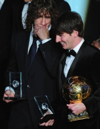Argentina's Lionel Messi (R) listens to