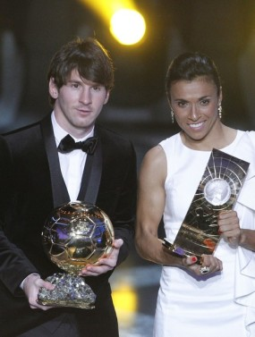 Messi of Argentina and Marta of Brazil hold their World Player 2010 trophies during the FIFA Ballon d'Or 2010 soccer awards ceremony in Zurich