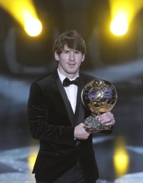 Messi of Argentina FIFA World Player 2010 holds trophy during the FIFA Ballon d'Or 2010 soccer awards ceremony in Zurich