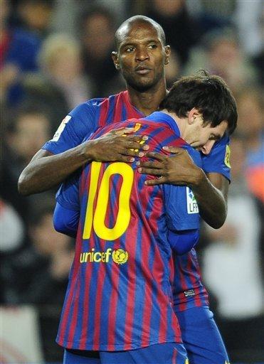 Lionel Messi, Eric Abidal