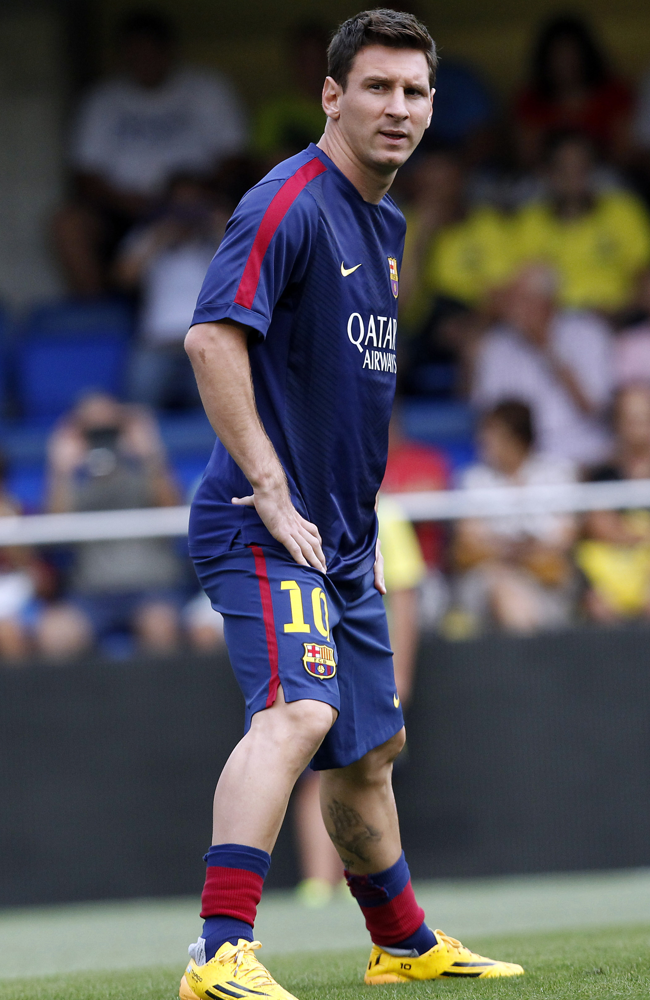 Barcelona's Lionel Messi looks on prior to the start of a Spanish La Liga soccer match against Villarreal at the Madrigal stadium in Villarreal, Spain, on Sunday, Aug 31, 2014.